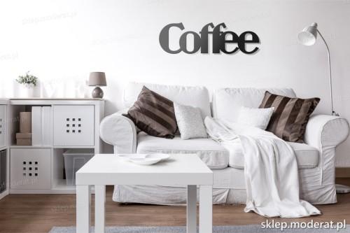 napis Coffee nad kanapą