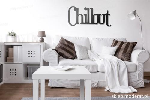 napis Chillout nad kanapą